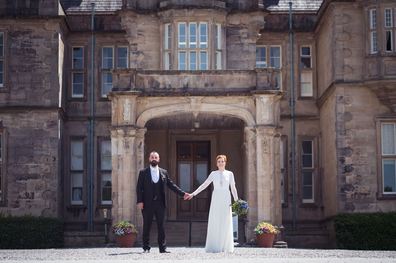bride and groom near castle