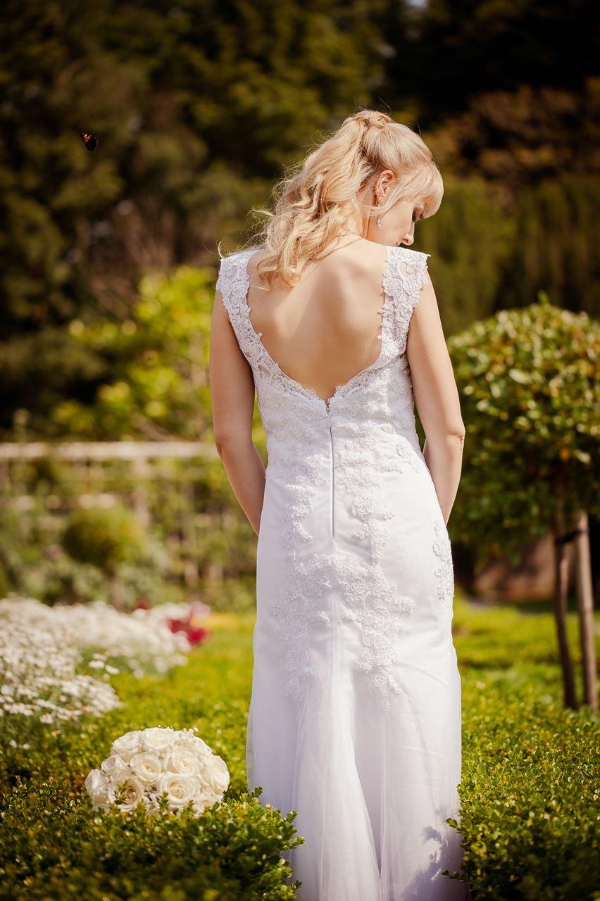 bride in white slim dress